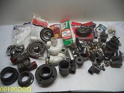 85 Piece lot: Plumbing fittings, braided hoses, facet, toile